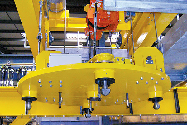 Specially designed nuclear crane lifting grapple with four twist-locks