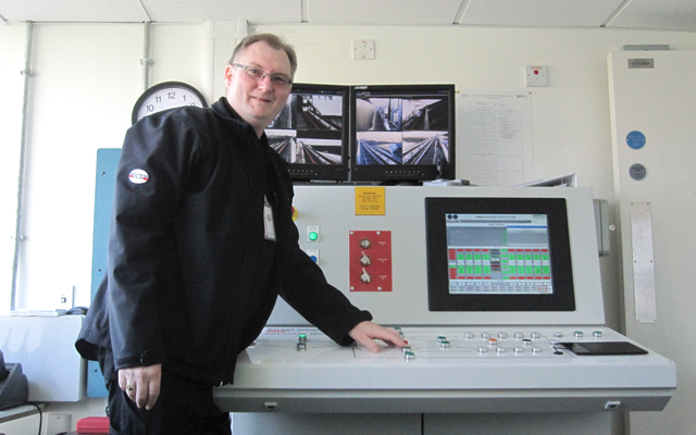 John Biggin, Wimbledon Project Manager, in front of the Centre Court retractable roof control desk