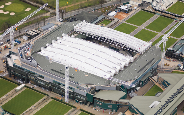 Wimbledon Centre Court with roof partially deployed to provide shade and windbreak