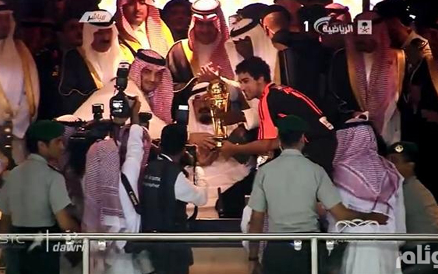 The King of Saudi Arabia presenting football players with a trophy